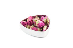Rose bud tea. Tea made from whole dried rose buds Stock Photo