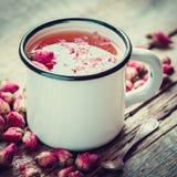 Rose buds tea in tea cup. Stock Image