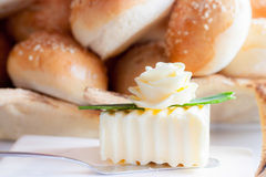 Rose of butter. Decorated piece of butter with baking at background Stock Image