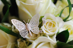 Rose & Butterfly. Brides roses with butterfly detail Stock Images