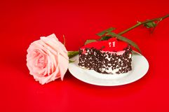 Rose and cake on red Stock Photos