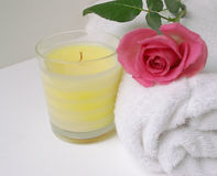 Rose Candel. Image of a pretty pink rose onWhite towel wth a scented cream candel Stock Image