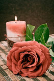 Rose and candle Stock Photography