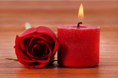 Rose and candle stock photos