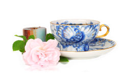 Rose, candle and blue cup of tee. Stock Photo