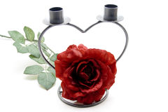 Rose and candle holder in heart form Royalty Free Stock Images