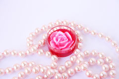 Rose candle and necklace royalty free stock images