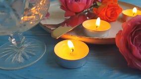 Rose candle , plate, slow motion elegant romance romantic surprise. Rose plate candle slow motion elegant surprise romance romantic