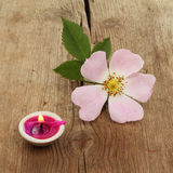 Rose and candle on wood Royalty Free Stock Photos