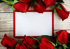 Rose and card. Roses  on wood background with decorations Stock Images