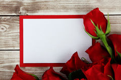 Rose and card. Roses  on wood background with decorations Royalty Free Stock Image