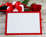Rose and card. Rose    on wood background with card Royalty Free Stock Images