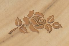 rose carved into stone surface Royalty Free Stock Images