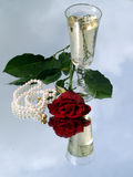 Rose and champagne Stock Photos