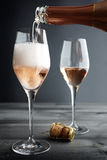Rose Champagne being filled into Glass Stock Image