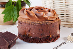 Rose chocolate mousse cake on a beautiful plate cream Stock Images