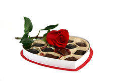 Rose and Chocolates. A red rose and a box of chocolates Stock Images