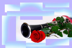 Rose clarinet comosition. Red rose and black clarinet composition over white over purple background Royalty Free Stock Photography