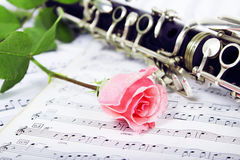 Rose clarinet composition. Beautiful rose and clarinet composition Royalty Free Stock Photos