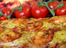 Rose colored garden prawns in wine marinade on tomato pizza Stock Images