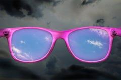 Rose-colored Gläser Stockfoto