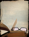 Rose-coloured spectacles and old books. Vintage background, rose-coloured spectacles and old books royalty free stock photo