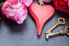 Rose con cuore e le chiavi Immagine Stock