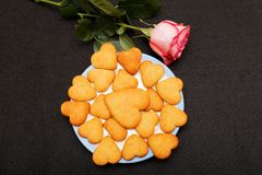 Rose and cookies Stock Photos