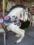 Rose covered Carousel Horse Stock Images