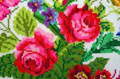 Rose by cross-stitch Stock Photography