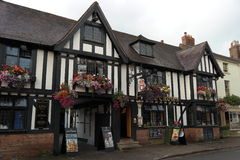 Rose and crown public house. Ancient rose and crown public house stratford on avon England black and white timber framed signs floral baskets Stock Images
