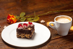 Rose, a cup of cappuccino and cake Royalty Free Stock Images