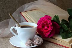 Rose, a cup of coffee Stock Photo