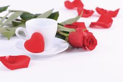Valentine`s Day. Rose with a Cup of coffee and hearts stock photos
