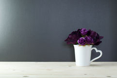 Rose in cup heart shape handle for love. Royalty Free Stock Photo