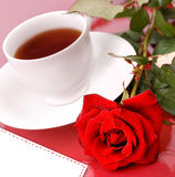 Rose with cup of tea. Stock Image