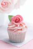 Rose cupcake. Cupcake decorated with a pink sugar rose royalty free stock photos