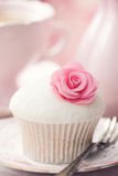 Rose cupcake. Cupcake decorated with a pink sugar rose Royalty Free Stock Photography