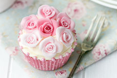Rose cupcake. Cupcake decorated with pink sugar roses royalty free stock images
