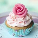 Rose cupcake. Single rose cupcake on a doily Stock Photography