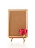 rose de rouge avec le conseil vide Photographie stock libre de droits