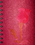 Rose de rouge de photo sur le carnet rouge Photographie stock libre de droits