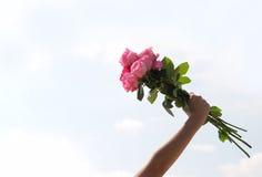 Rose in der Hand Lizenzfreie Stockbilder