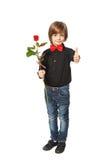 Rose in der Hand eines Jungen Stockfotografie