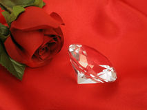 Rose with Diamond on Red Satin Stock Photo