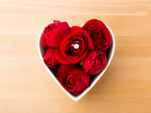 Rose with diamond ring inside the heart shape bowl Stock Photography
