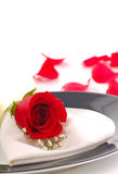 Rose on a dinner plate. In a romantic setting Stock Photo