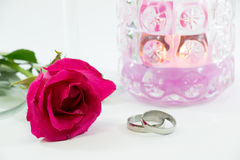 Rose and engage ring near champagne glasses, and candle in Valen Stock Image