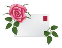 Rose and envelope. Blank envelope with a stamp with heart and rose behind it Stock Photography