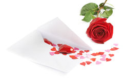 Rose and envelope filled with hearts Royalty Free Stock Image
